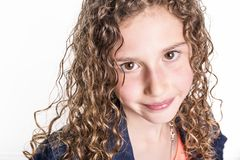Portrait of happy, smiling, confident 9 years old girl with curly hair, isolated on white. A Portrait of happy, smiling, confident 9 years old girl with curly Stock Photos