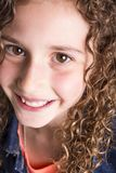 Portrait of happy, smiling, confident 9 years old girl with curly hair,  on white Royalty Free Stock Images