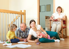 Portrait of happy smiling couple with children and  grandmother. Portrait of happy couple with children and  grandmother in home interior together Stock Photo