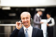 Customer service operator working in office. Consulting and assistance service call center. Portrait of happy smiling customer support phone operator in headset Royalty Free Stock Image