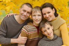 Smiling family in autumn forest Royalty Free Stock Image