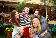 Portrait of a happy smiling family in flower garden stock image