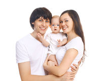 Portrait happy smiling family, mother and father with baby on white Stock Photography