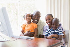 Portrait happy smiling family using computer. At home stock image