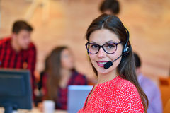 Portrait of happy smiling female customer support phone operator at workplace. Portrait of happy smiling female customer support phone operator at workplace royalty free stock images