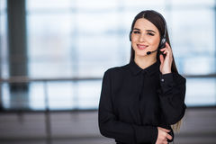 Portrait of happy smiling female customer support phone operator at workplace background. Portrait of happy smiling female customer support phone operator at Stock Images