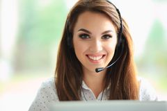 Portrait of happy smiling female customer support phone operator at workplace. Female customer support operator with headset and smiling stock photos