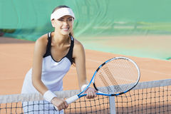 Portrait of Happy Smiling Female Tennis Player at Court Royalty Free Stock Image