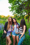 Portrait of happy smiling friends on weekend outdoor. Three beautiful young happy best friends having fun, smiling Royalty Free Stock Image
