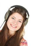 A portrait of happy smiling girl is in headsets Stock Photos
