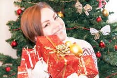Portrait of happy smiling girl holding christmas gift boxes. Stock Photos