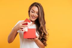 Portrait of a happy smiling girl opening gift box Stock Photo