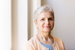 Portrait of happy smiling gray senior woman Stock Photography