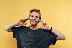 Portrait of Happy Smiling Guy Listening to Music Stock Images