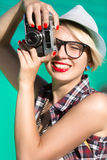 Portrait of happy smiling hipster girl with red lipstick making Stock Images