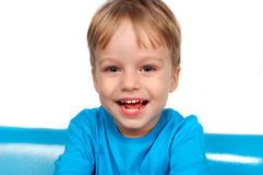 Portrait of happy smiling little boy on white background Royalty Free Stock Photo