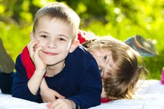 Portrait of happy smiling little children boy and girl on sunny Royalty Free Stock Photos