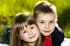 Portrait of happy smiling little children boy and girl on sunny Stock Image