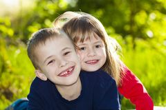 Portrait of happy smiling little children boy and girl on sunny Stock Photo