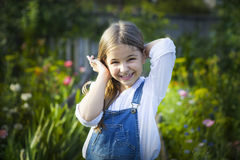 Portrait of happy smiling little girl in sunny garden Stock Image