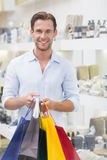 Portrait of a happy smiling man with shopping bags Stock Photos