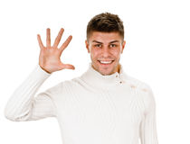 Portrait of happy smiling man showing five fingers Stock Photo