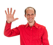 Portrait of happy smiling man showing five fingers Stock Image
