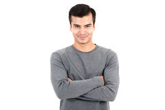 Portrait of happy smiling man wearing casual gray t-shirt, crossing his arms Stock Images