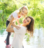 Portrait happy smiling mother and child daughter having fun. In summer day Royalty Free Stock Images