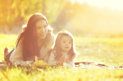 Portrait happy smiling mother and child together in autumn Royalty Free Stock Photo