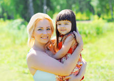 Portrait of happy smiling mother and child together outdoors Royalty Free Stock Photo