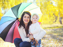 Portrait happy smiling mother and child with umbrella in autumn Stock Image