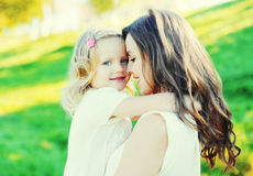 Portrait happy smiling mother hugging child daughter. Closeup in summer Royalty Free Stock Images