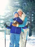 Portrait happy smiling mother hugging child with ski in winter stock photos