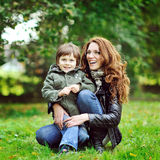 Portrait of happy smiling mother and son in a park Royalty Free Stock Images