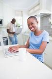 Portrait of a happy smiling pretty woman using her laptop Royalty Free Stock Photo