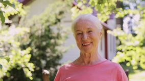 Portrait of happy smiling senior woman outdoors stock video footage