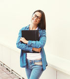 Portrait of happy smiling student girl in glasses with folder Stock Photo