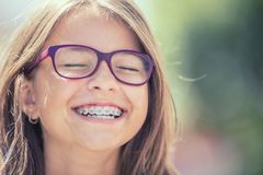 Portrait of a happy smiling teenage girl with dental braces and royalty free stock photography