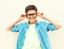 Portrait happy smiling teenager boy in glasses wearing a checkered shirt stock photo