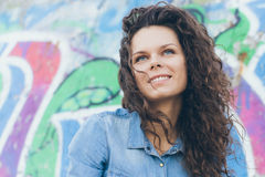 Portrait of happy smiling woman with blue eyes and curly hair  Royalty Free Stock Photo