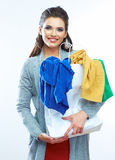 Portrait of happy smiling woman hold shopping bag with clothes. Stock Photo