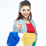 Portrait of happy smiling woman hold shopping bag with clothes. Female model  white  background Stock Photo