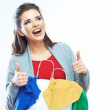 Portrait of happy smiling woman hold shopping bag with clothes. Thumb show. Female model isolated white  background Royalty Free Stock Images