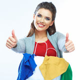 Portrait of happy smiling woman hold shopping bag with clothes. Thumb show. Female model isolated white  background Royalty Free Stock Photo