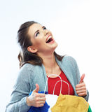 Portrait of happy smiling woman hold shopping bag. With clothes. Thumb show. Female model isolated white  background Royalty Free Stock Photo