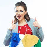 Portrait of happy smiling woman hold shopping bag with clothes. Thumb show. Female model  white  background Royalty Free Stock Photography