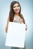 Portrait of happy smiling woman hold shopping bag. Female mode Royalty Free Stock Image