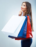 Portrait of happy smiling woman hold shopping bag. Female mode. L isolated studio background Royalty Free Stock Photos