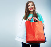 Portrait of happy smiling woman hold shopping bag. Female mode. L isolated studio background Stock Photo